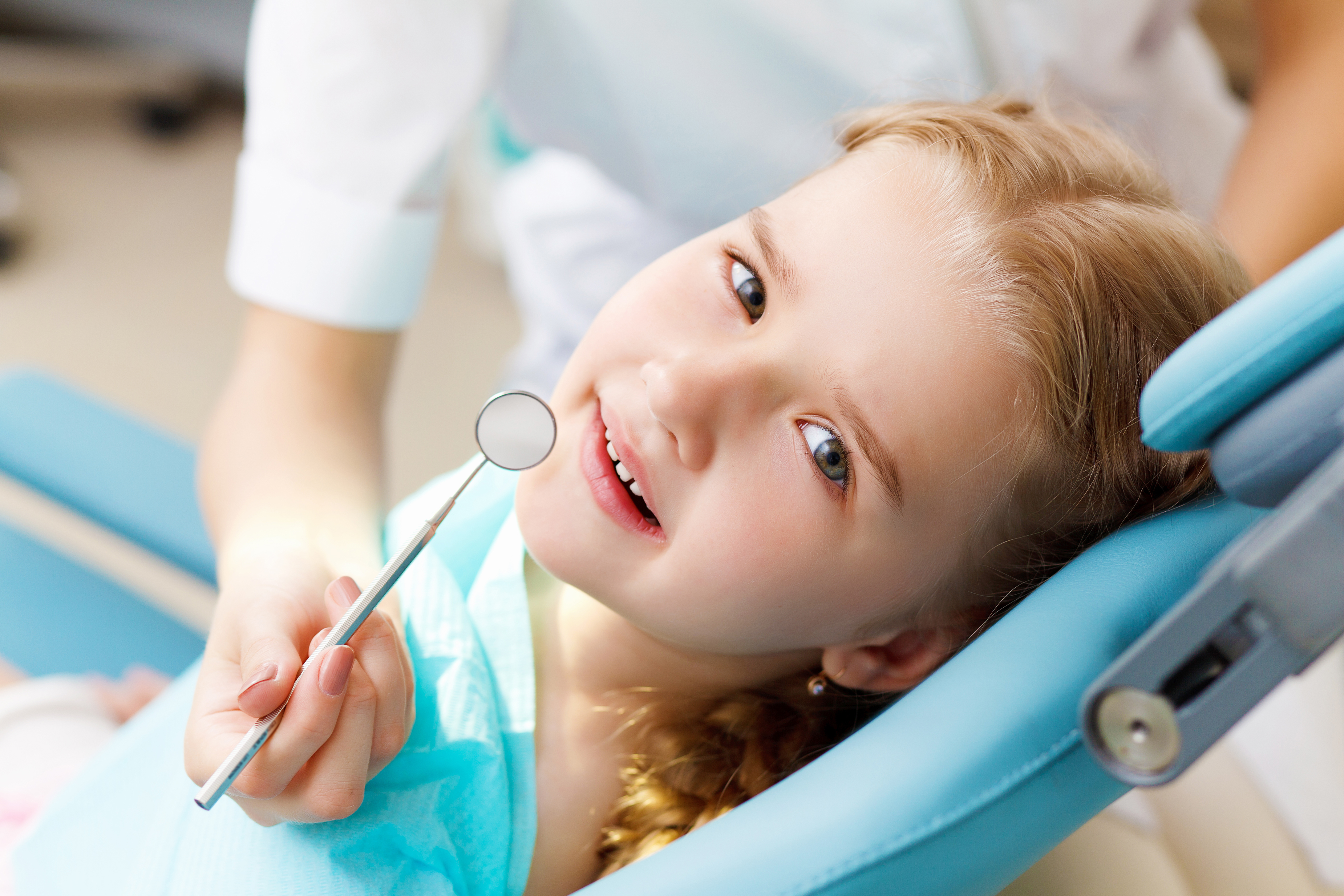 bigstock-little-girl-visiting-dentist-35934937